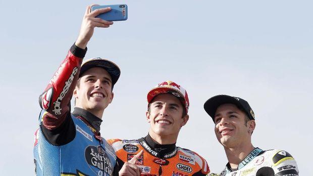 Marc Marquez dan Alex Marquez meraih juara dunia MotoGP dan Moto2 2019. (