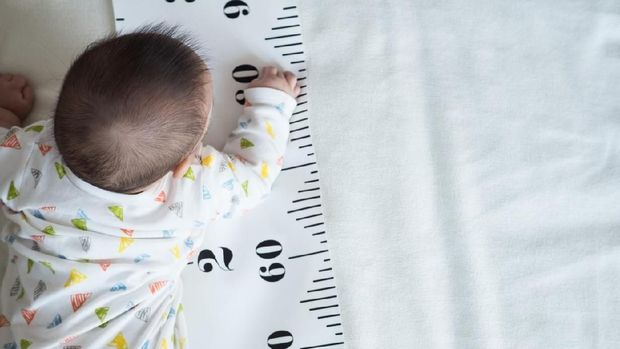 concept of baby growth, height, development
