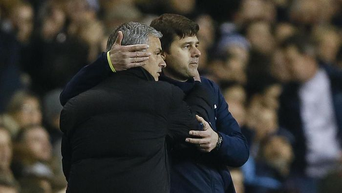 FILE - In this Thursday, Jan. 1, 2015 file photo Tottenham manager Mauricio Pochettino, right, embraces Chelsea manager Jose Mourinho at the end of the English Premier League soccer match between Tottenham Hotspur and Chelsea at White Hart Lane Stadium in London. Jose Mourinho sealed a return to coaching after almost a year out when he was hired as Tottenham manager on Wednesday Nov. 20, 2019 a day after the Premier League club fired Mauricio Pochettino. (AP Photo/Kirsty Wigglesworth, File)