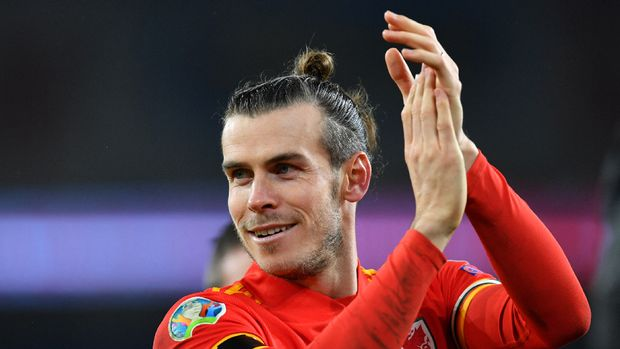 Wales' forward Gareth Bale celebrates victory and qualification after the Group E Euro 2020 football qualification match between Wales and HUngary at Cardiff City Stadium in Cardiff, Wales on November 19, 2019. Wales beat Hungary 2-0 to qualify. Paul ELLIS / AFP