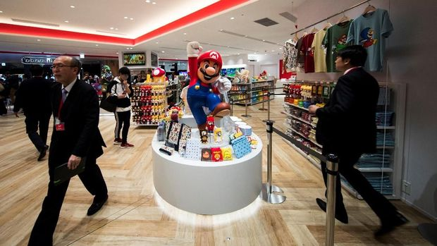 Goods of Nintendo game character Mario are displayed at a new Nintendo store during a press preview in Tokyo on November 19, 2019. - Nintendo opens the doors this week at its first brick-and-mortar store in Tokyo, offering everything from Super Mario mugs to Zelda handbags at a complex targeting visiting gamers and local enthusiasts. (Photo by Behrouz MEHRI / AFP)