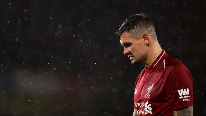 Dejan Lovren diyakinkan Juergen Klopp agar tidak meninggalkan Liverpool di bursa musim panas lalu. (Foto: Richard Heathcote / Getty Images)