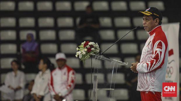 Menpora, Zainudin Amali saat memimpin upacara pengukuhan kontingen atlet Indonesia untuk SEA Games 2019 di Hall Bola Basket, GBK, Jakarta, Rabu, 27 November 2019. CNN Indonesia/Bisma Septalisma