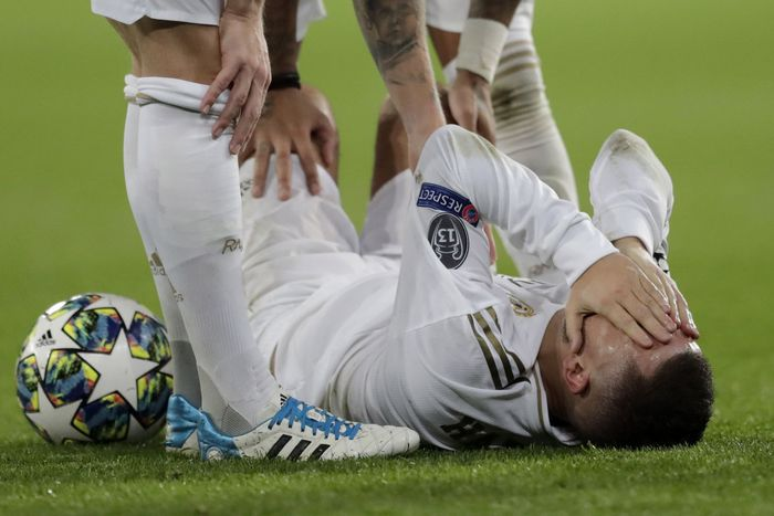 Real Madrids Eden Hazard reacts injured at the ground during a Champions League soccer match Group A between Real Madrid and Paris Saint Germain at the Santiago Bernabeu stadium in Madrid, Spain, Tuesday, Nov. 26, 2019. (AP Photo/Bernat Armangue)