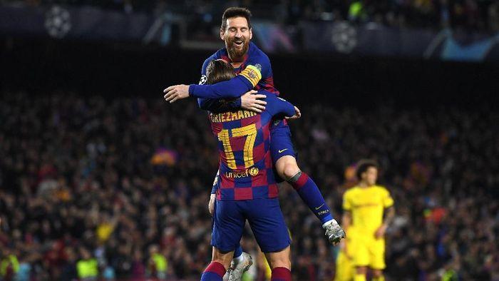 Antoine Griezmann mencetak gol ke gawang Borussia Dortmund usai mendapat assist dari Lionel Messi (Foto: David Ramos/Getty Images)