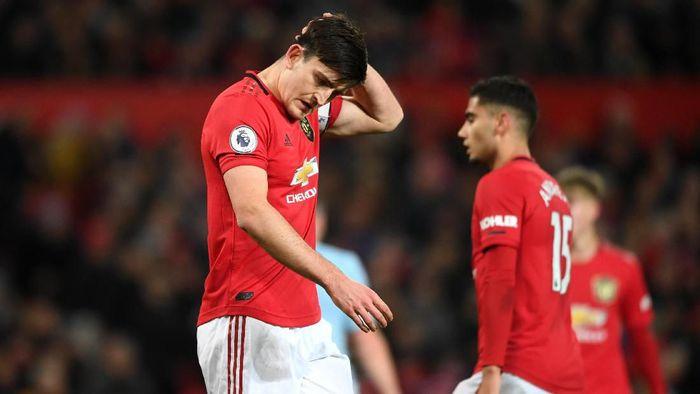 Harry Maguire meyakini masalah Manchester United di musim ini adalah inkonsistensi. Foto: Stu Forster/Getty Images