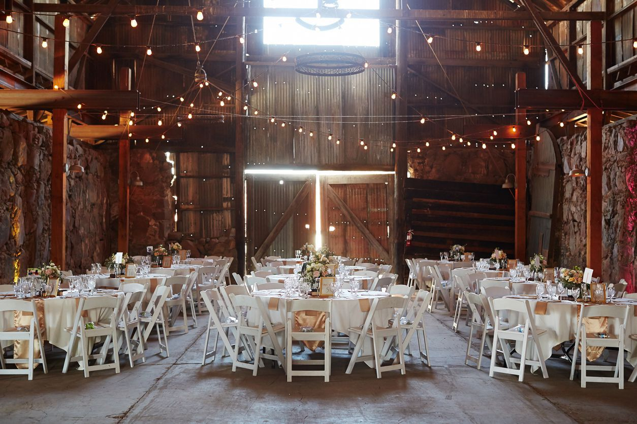 Outdoor wedding ceremony venue with arch and decoration