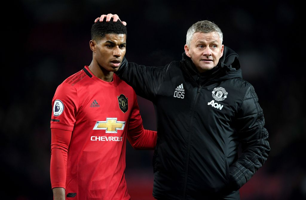 MANCHESTER, ENGLAND - DECEMBER 01: Marcus Rashford of Manchester United is consolled by Ole Gunnar Solskjaer, Manager of Manchester United after the Premier League match between Manchester United and Aston Villa at Old Trafford on December 01, 2019 in Manchester, United Kingdom. (Photo by Stu Forster/Getty Images)
