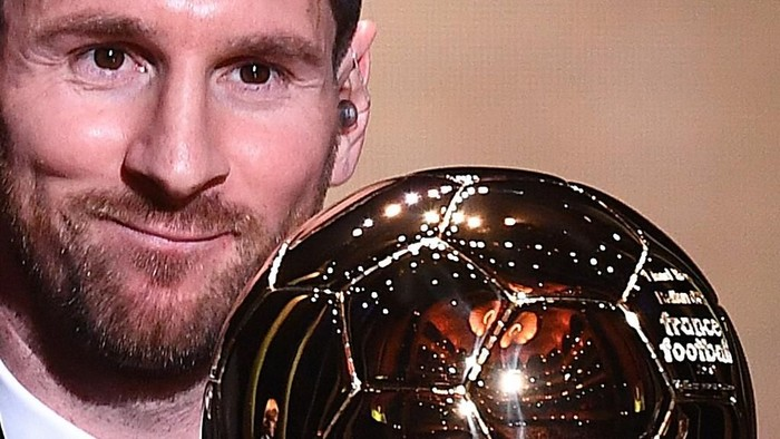Barcelonas Argentinian forward Lionel Messi reacts after winning the Ballon dOr France Football 2019 trophy at the Chatelet Theatre in Paris on December 2, 2019. - Lionel Messi won a record-breaking sixth Ballon dOr on Monday after another sublime year for the Argentinian, whose familiar brilliance remained undimmed even through difficult times for club and country. (Photo by FRANCK FIFE / AFP)