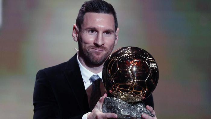 Barcelonas soccer player Lionel Messi holds the trophy of the Golden Ball award ceremony in Paris, Monday, Dec. 2, 2019. Messi won the Ballon dOr for sixth time. (AP Photo/Francois Mori)