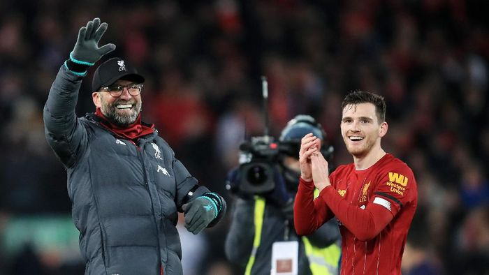 LIVERPOOL, ENGLAND - NOVEMBER 30: Jurgen Klopp, Manager of Liverpool and Andy Robertson of Liverpool celebrate win after the Premier League match between Liverpool FC and Brighton & Hove Albion at Anfield on November 30, 2019 in Liverpool, United Kingdom. (Photo by Marc Atkins/Getty Images)