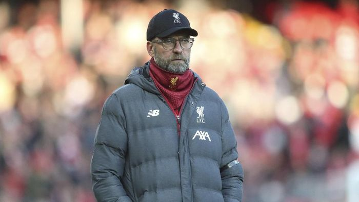 Liverpools manager Jurgen Klopp watches players warm up before the English Premier League soccer match between Liverpool and Brighton at Anfield Stadium, Liverpool, England, Saturday, Nov. 30, 2019. (AP Photo/Jon Super)