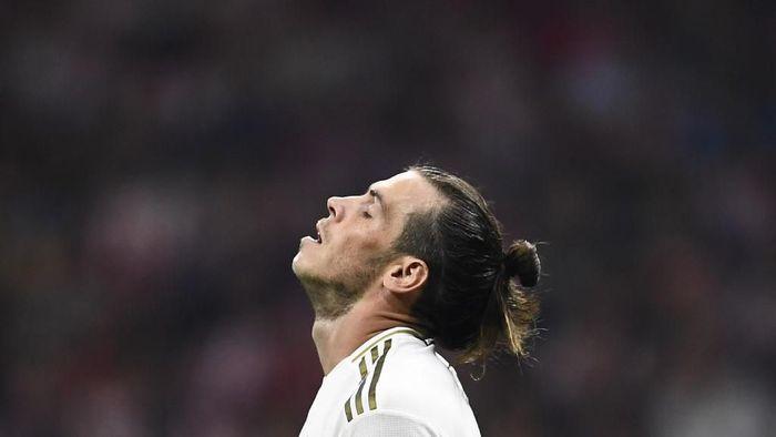 Gareth Bale dipastikan absen dalam dua laga Real Madrid akibat cedera yang membekapnya (Foto: OSCAR DEL POZO / AFP)