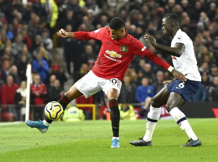 Manchester Uniteds Marcus Rashford, left, and Tottenhams Davinson Sanchez challenge for the ball during the English Premier League soccer match between Manchester United and Tottenham Hotspur at Old Trafford in Manchester, England, Wednesday, Dec. 4, 2019. (AP Photo/Rui Vieira)