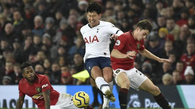 Manchester United's Fred, left, Tottenham's Son Heung-min, centre, and Manchester United's Daniel James challenge for the ball during the English Premier League soccer match between Manchester United and Tottenham Hotspur at Old Trafford in Manchester, England, Wednesday, Dec. 4, 2019. (AP Photo/Rui Vieira)