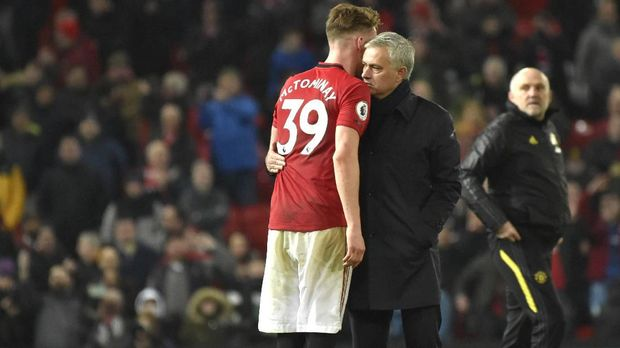 Tottenham's manager Jose Mourinho and Manchester United's Scott McTominay at the end of the English Premier League soccer match between Manchester United and Tottenham Hotspur at Old Trafford in Manchester, England, Wednesday, Dec. 4, 2019. (AP Photo/Rui Vieira)