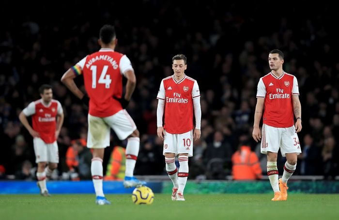 LONDON, ENGLAND - DECEMBER 05: Mesut Ozil of Arsenal and Granit Xhaka of Arsenal are looking dejected after Neal Maupay of Brighton scored during the Premier League match between Arsenal FC and Brighton & Hove Albion at Emirates Stadium on December 05, 2019 in London, United Kingdom. (Photo by Marc Atkins/Getty Images)