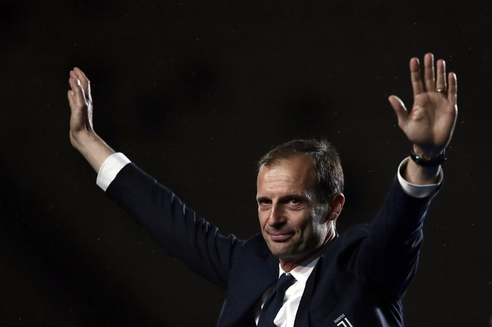 Juventus' Italian coach Massimiliano Allegri celebrates the team's winning the Italian Champion's trophy at the end of the Italian Serie A football match Juventus vs Atalanta on May 19, 2019 at the Allianz stadium in Turin. (Photo by Isabella BONOTTO / AFP)