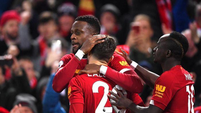 Liverpool mau tak mau harus melakukan rotasi menghadapi jadwal padat bulan ini (Laurence Griffiths/Getty Images)