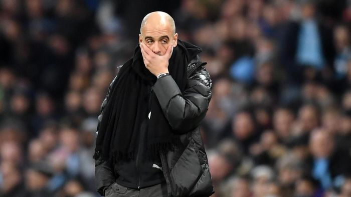MANCHESTER, ENGLAND - DECEMBER 07: Pep Guardiola, Manager of Manchester City recats during the Premier League match between Manchester City and Manchester United at Etihad Stadium on December 07, 2019 in Manchester, United Kingdom. (Photo by Michael Regan/Getty Images)