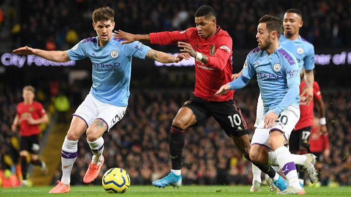 Manchester United unggul 2-0 atas Manchester City di babak pertama (Foto: Michael Regan/Getty Images)