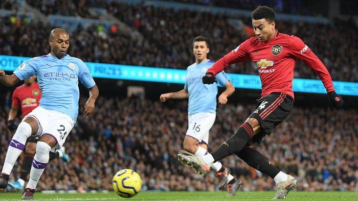 Manajer Manchester United Ole Gunnar Solskjaer menilai Jesse Lingard sudah kembali ke performa terbaiknya (Foto: Michael Regan/Getty Images)