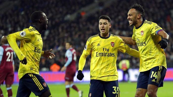 Arsenal lega setelah memutus puasa kemenangan di Liga Inggris. (Foto: Kirsty Wigglesworth / AP Photo)