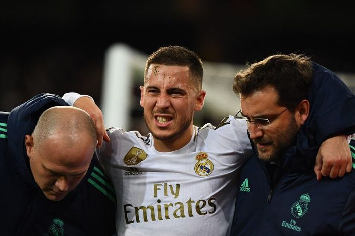 (FILES) In this file photo taken on November 26, 2019 Real Madrids Belgian forward Eden Hazard gestures in pain during the UEFA Champions League group A football match Real Madrid against Paris Saint-Germain FC at the Santiago Bernabeu stadium in Madrid. - Eden Hazard is set to miss the Clasico against Barcelona after further tests revealed a fracture in his right ankle, Real Madrid confirmed on December 5, 2019. (Photo by GABRIEL BOUYS / AFP)