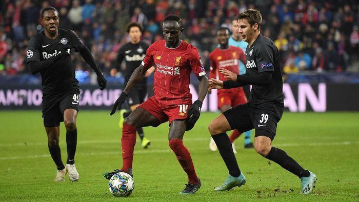 Sadio Mane minta maaf kepada bekas klubnya, RB Salzburg karena membantu Liverpool lolos. (Foto: Michael Regan / Getty Images)
