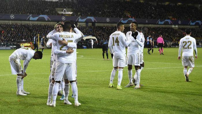 Real Madrid menaklukkan Club Brugge 3-1 di laga terakhir grup Liga Champions (Foto: Photo by JOHN THYS / AFP)