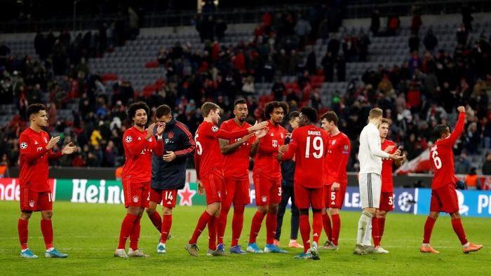 Bayern Munichs players celebrate after winnin 3-1 the UEFA Champions League Group B football match between Bayern Munich and Tottenham FC on December 11, 2019 in Munich, Germany. (Photo by Odd ANDERSEN / AFP)