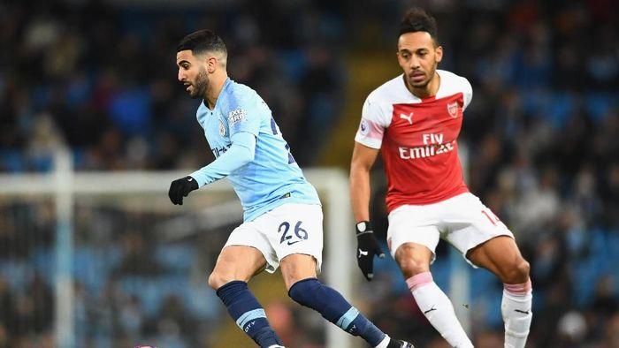 Laga Arsenal vs Manchester City akan meramaikan pekan ke-17 Liga Inggris (Foto: Clive Mason/Getty Images)