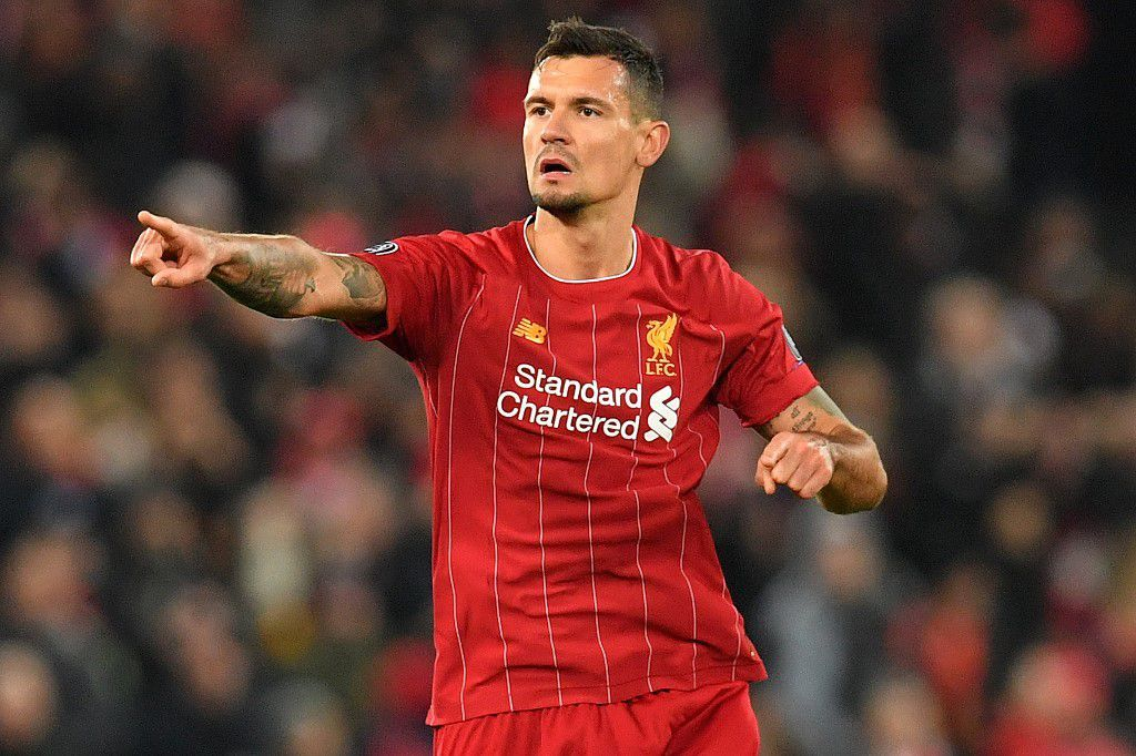 Liverpool's Croatian defender Dejan Lovren celebrates scoring equalising goal during the UEFA Champions league Group E football match between Liverpool and Napoli at Anfield in Liverpool, north west England on November 27, 2019. (Photo by Paul ELLIS / AFP)