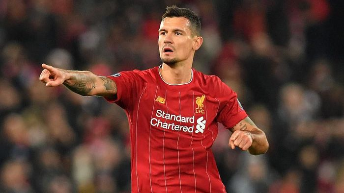 Liverpools Croatian defender Dejan Lovren celebrates scoring equalising goal during the UEFA Champions league Group E football match between Liverpool and Napoli at Anfield in Liverpool, north west England on November 27, 2019. (Photo by Paul ELLIS / AFP)