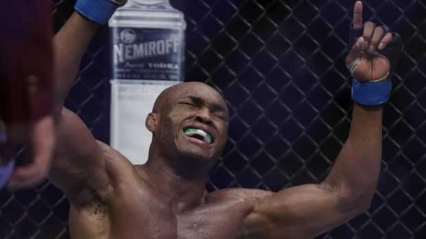 LAS VEGAS, NEVADA - MARCH 02: Kamaru Usman, of Nigeria, celebrates after defeating Tyron Woodley in a welterweight title bout during UFC 235 at T-Mobile Arena on March 02, 2019 in Las Vegas, Nevada. Usman won by unanimous decision.   Isaac Brekken/Getty Images/AFP