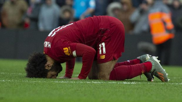 Liverpool's Mohamed Salah celebrates after scoring his sides second goal during the English Premier League soccer match between Liverpool and Watford at Anfield stadium in Liverpool, England, Saturday, Dec. 14, 2019. (AP Photo/Rui Vieira)