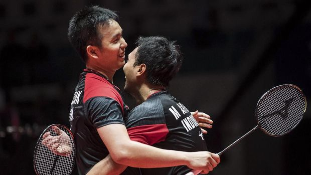 Hendra Setiawan (L) of Indonesia celebrates with partner Mohammad Ahsan after winning their men's doubles final match against Hiroyuki Endo and Yuta Watanabe of Japan at the BWF World Tour Finals badminton tournament in Guangzhou in China's southern Guangdong province on December 15, 2019. (Photo by STR / AFP) / China OUT