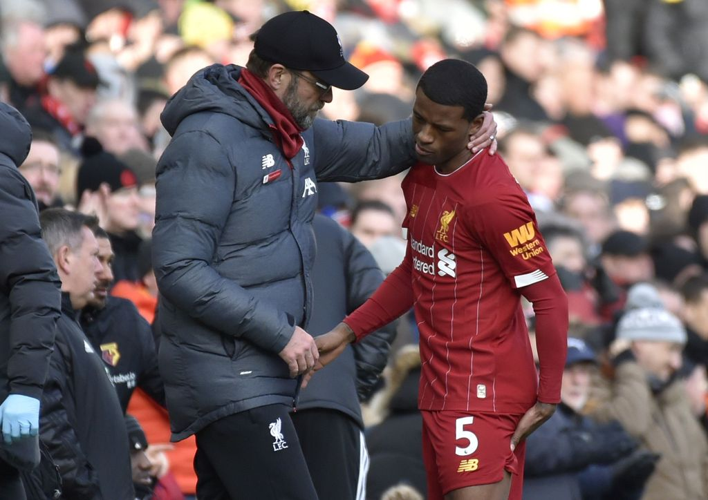 Liverpool's manager Jurgen Klopp, left, talks to Liverpool's Georginio Wijnaldum after he suffered an injury during the English Premier League soccer match between Liverpool and Watford at Anfield stadium in Liverpool, England, Saturday, Dec. 14, 2019. (AP Photo/Rui Vieira)