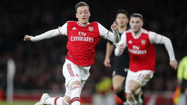Arsenal's Mesut Ozil controls the ball during the English Premier League soccer match between Arsenal and Brighton, at the Emirates Stadium in London, Thursday, Dec. 5, 2019. (AP Photo/Frank Augstein)