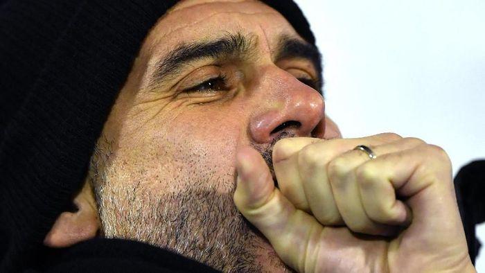 Pep Guardiola akan berhadapan dengan Real Madrid di babak 16 besar Liga Champions. (Foto: Dan Mullan/Getty Images)