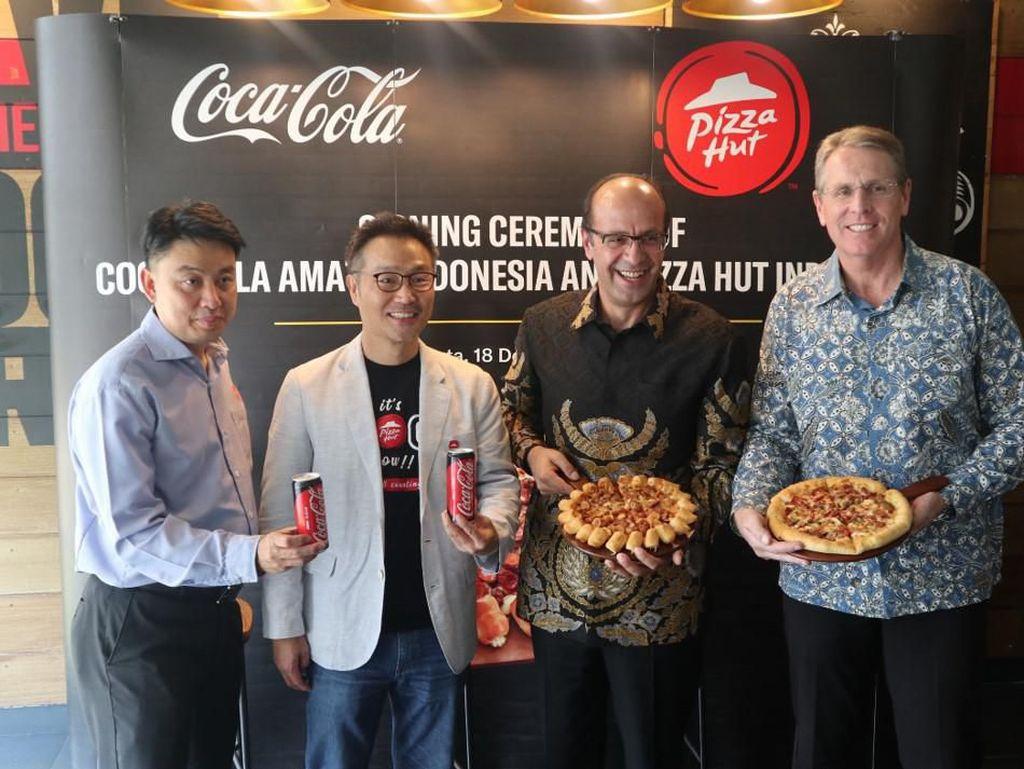 Giliran Pizza Hut Dipersunting Coca Cola
