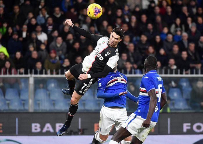 Juventus Cristiano Ronaldo, top, scores his sides second goal during a Serie A soccer match between Sampdoria and Juventus, at Luigi Ferraris stadium in Genoa, Italy, Wednesday, Dec. 18, 2019. (Luca Zennaro/ANSA via AP)