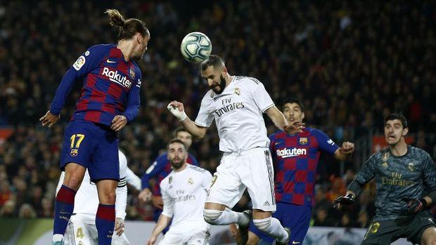 Barcelona bermain imbang tanpa gol lawan Real Madrid. (