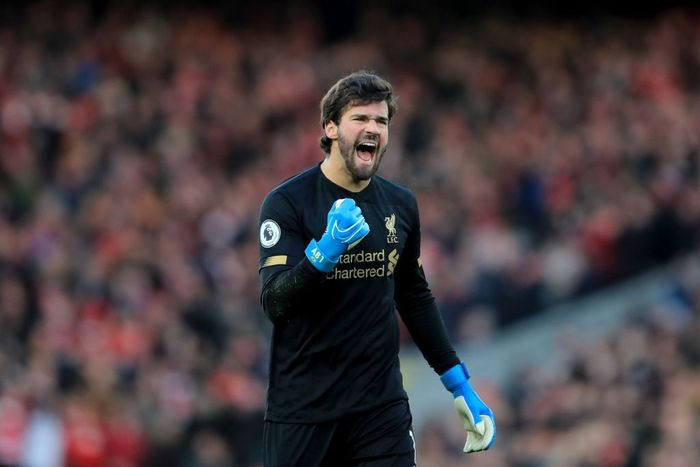 LIVERPOOL, ENGLAND - NOVEMBER 30: Alisson of Liverpool celebrates  during the Premier League match between Liverpool FC and Brighton & Hove Albion at Anfield on November 30, 2019 in Liverpool, United Kingdom. (Photo by Marc Atkins/Getty Images)