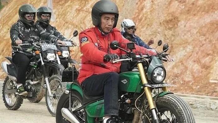 Jokowi mengenakan jaket dengan goresan grafiti. (Foto: dok. Biro Setpres Istana)