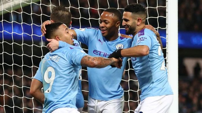 MANCHESTER, ENGLAND - DECEMBER 21: Gabriel Jesus of Manchester City celebrates with teammates after scoring his teams third goal during the Premier League match between Manchester City and Leicester City at Etihad Stadium on December 21, 2019 in Manchester, United Kingdom. (Photo by Clive Brunskill/Getty Images)