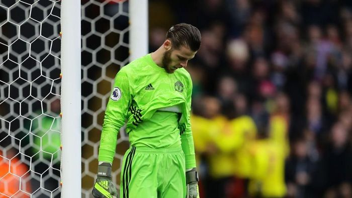 WATFORD, ENGLAND - DECEMBER 22: David De Gea of Manchester United looks dejected after failing to save a penalty which resulted in the second goal for Watford scored by Troy Deeney of Watford (not pictured) during the Premier League match between Watford FC and Manchester United at Vicarage Road on December 22, 2019 in Watford, United Kingdom. (Photo by Richard Heathcote/Getty Images)