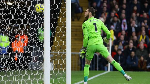 WATFORD, ENGLAND - DECEMBER 22: David De Gea of Manchester United fails to save a shot from Ismaila Sarr of Watford (not pictured) which results in the first goal for Watford scored by Ismaila Sarr of Watford during the Premier League match between Watford FC and Manchester United at Vicarage Road on December 22, 2019 in Watford, United Kingdom. (Photo by Richard Heathcote/Getty Images)