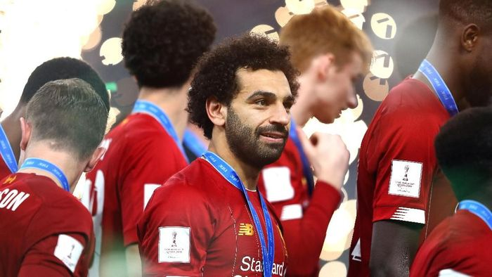 DOHA, QATAR - DECEMBER 21: Mohamed Salah of Liverpool looks on after receiving his winners meal during the trophy presentation following the FIFA Club World Cup Qatar 2019 Final between Liverpool FC and CR Flamengo at Education City Stadium on December 21, 2019 in Doha, Qatar. (Photo by Francois Nel/Getty Images)