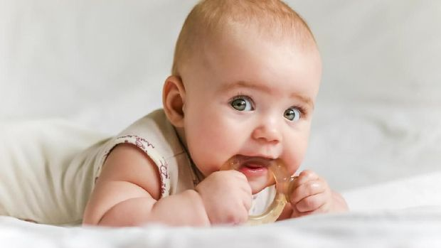 Cute baby with teether